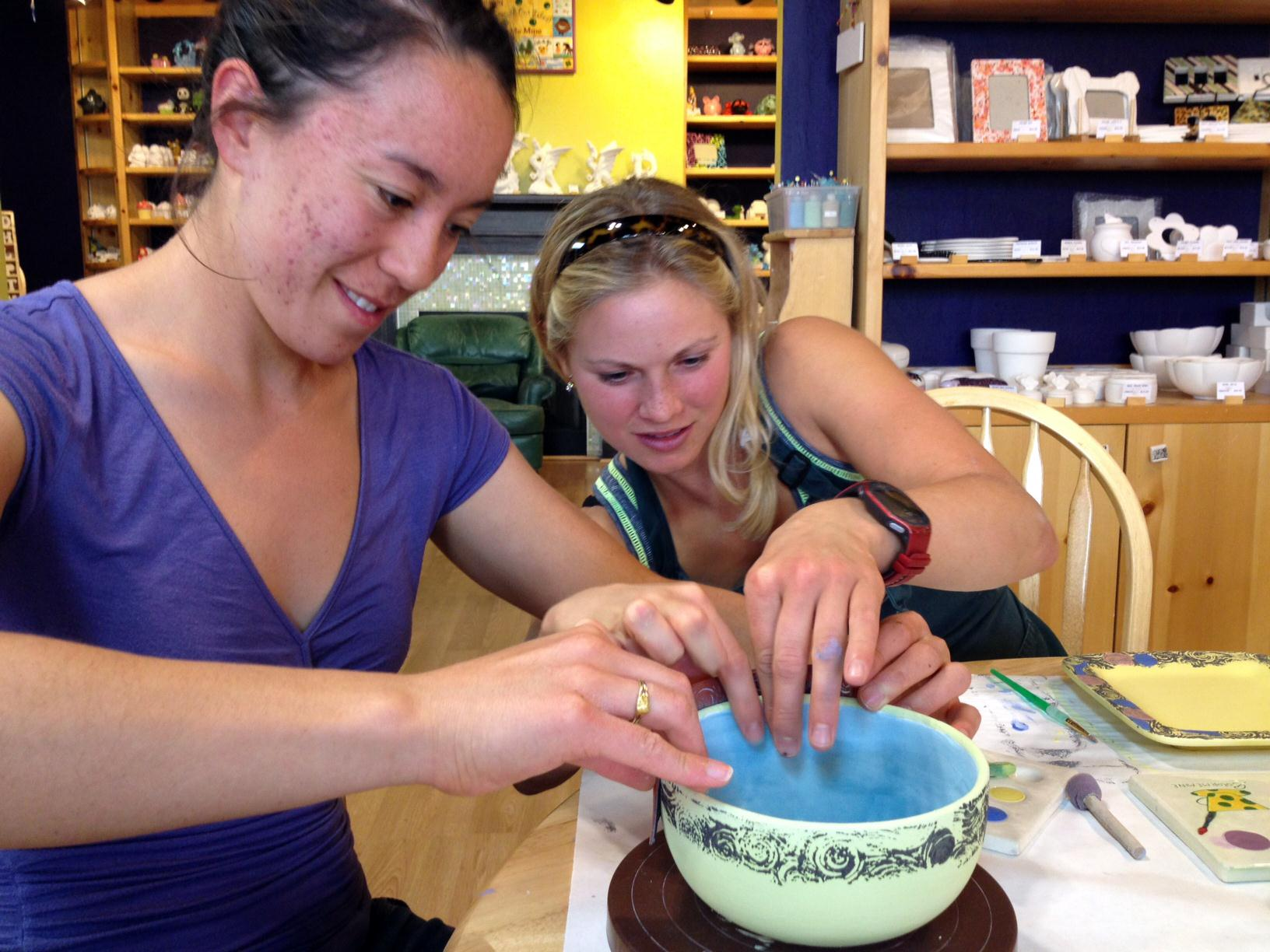 Helping Emily rubber stamp a beautiful bowl (photo from Chandra)