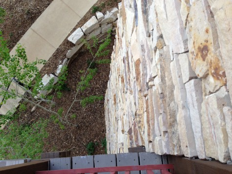 View from the deck down. Awesome rock wall!