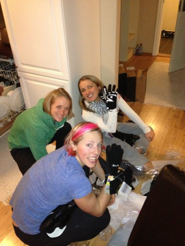 Kikkan, Liz and Holly digging through the glove bag