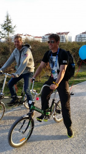 Erik and Bird on the village bikes...Erik's came with a clown nose and Bird's with a balloon!
