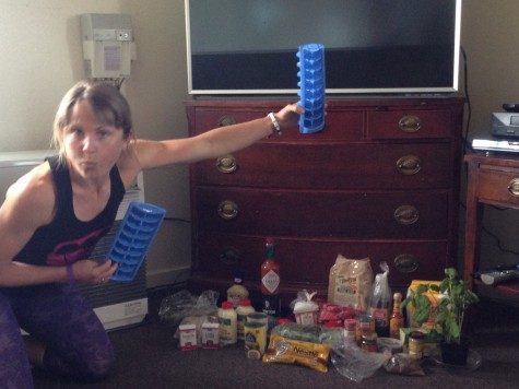 "Holly posing with our pile of goodies! Everyone brought up a secret ingredient or spice to ""spice up"" camp!"