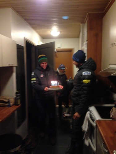 Simi bringing out Andy's birthday cake! We celebrated in Ruka.