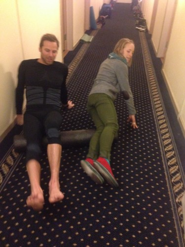 Andy and Liz sharing a foam roller, doing some classic US team hallway recovery after racing.