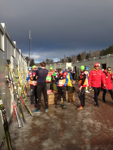The coaches outside the wax cabins, waiting to see who made it through to the sprint heats