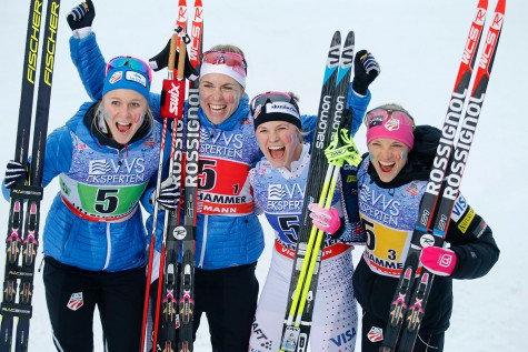 Third placed US team Jessica Diggins, Elizabeth Stephen, Sadie Bjornsen and Rosie Brennan pose on December 6, 2015 after the 4x5 km realy women cross-country event at the FIS ski World Cup in Lillehammer.   (Photo credit: POPPE/AFP/Getty Images)