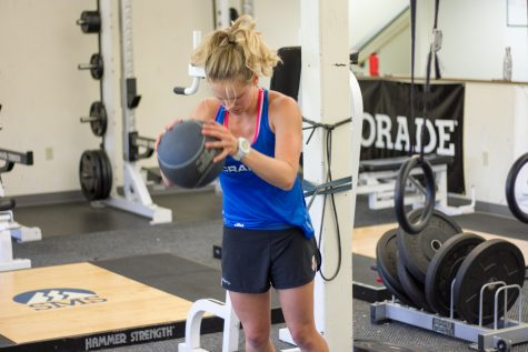 Me, getting after the med ball slams in the gym (photo from Reese Brown/SIA Images)