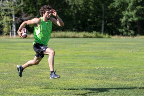Ben, combining bounding with a pickup game of football. Gym time can be pretty fun sometimes! (photo from Reese Brown/SIA Images)