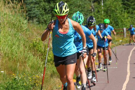 Getting our bounding on while roller skiing! (photo from Bruce Adelsman/Skinnyski.com)