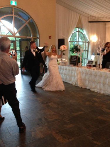 The bride and groom dancing in!