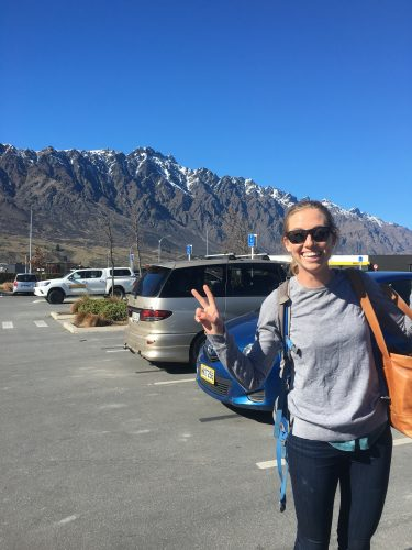 "Erika at the Queenstown airport with ""The Remarkables"" mountains in the background."