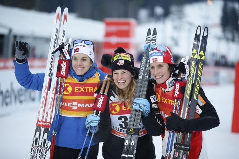 Winner Jessica Diggins of USA (C), second placed Heidi Weng of Norway (L) and third placed Marit Bjorgen of Norway (R), pose after the women's Cross Country 5 km event at the FIS World Cup in Lillehammer, Norway on December 03, 2016. (Photo credit  TERJE PEDERSEN/AFP/Getty Images)