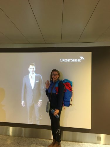 Sophie hamming it up with Federer's talking image in the Zurich airport.
