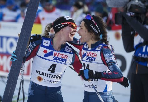 Teammate hugs in the finish with Chelsea Holmes! (Photo by Nils Petter Nilsson/Getty Images)